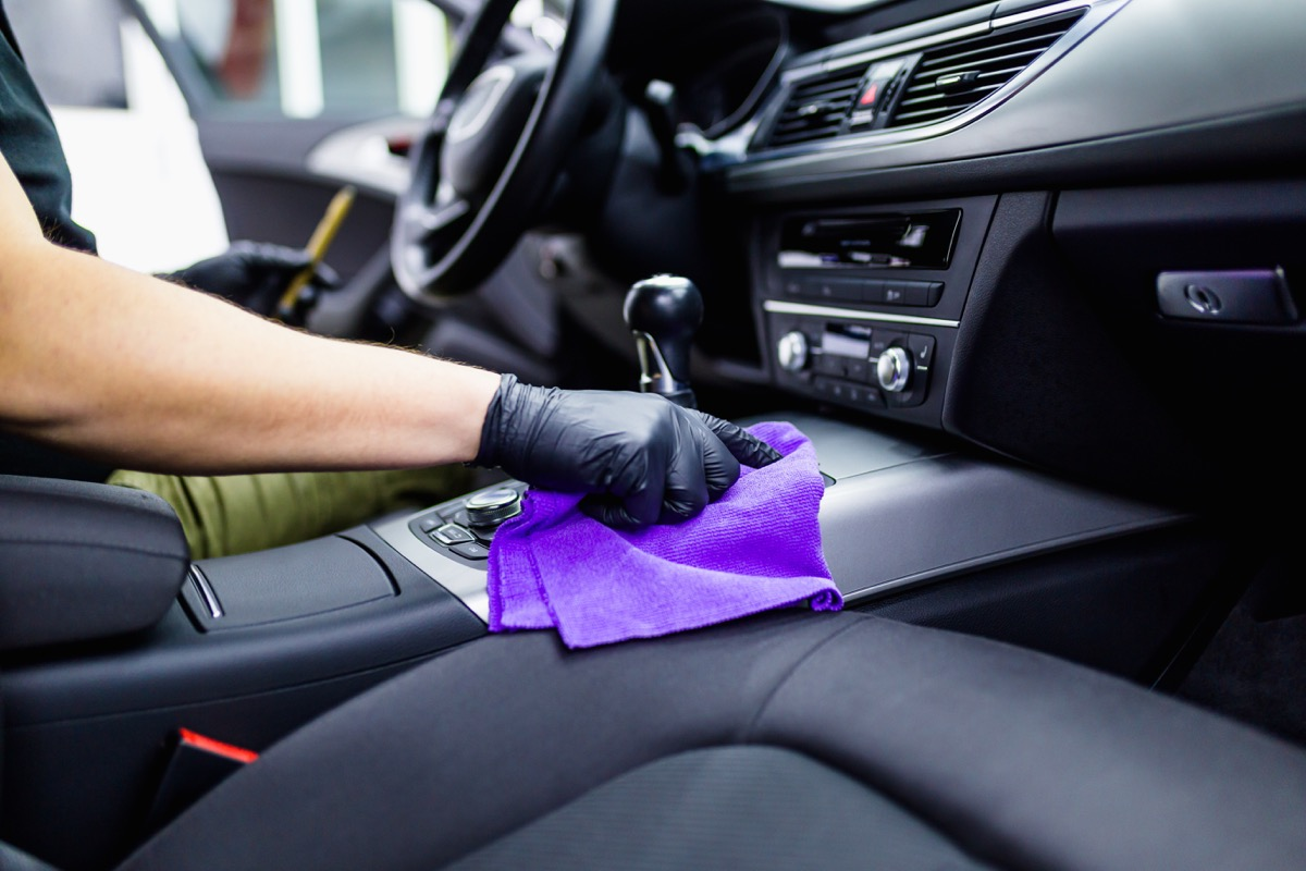 A man cleaning car interior, car detailing
