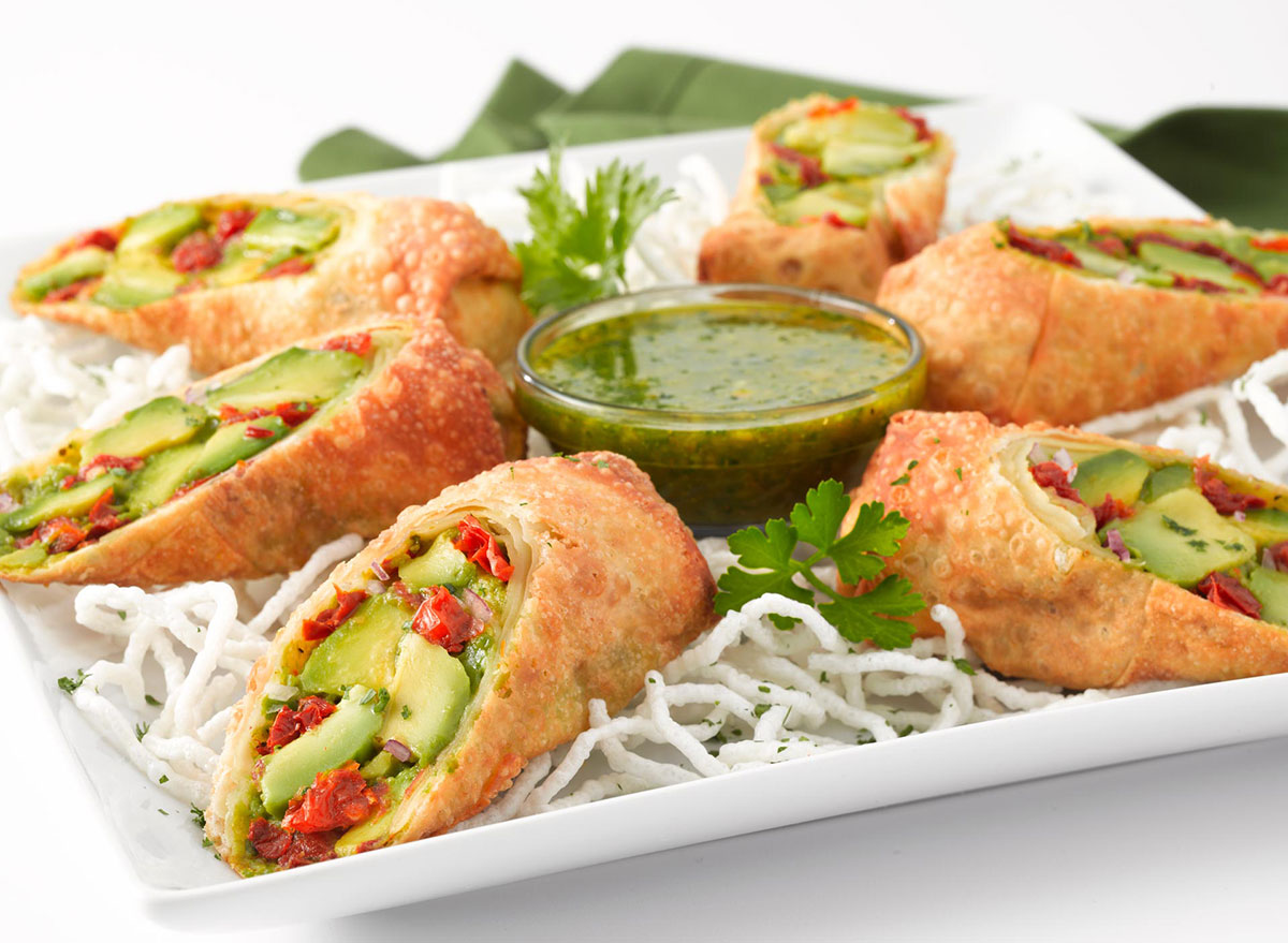 cheesecake factory avocado egg rolls on white serving dish with green dip