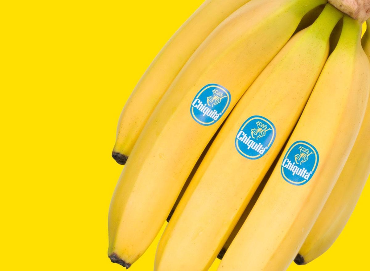 bunch of chiquita bananas on yellow background
