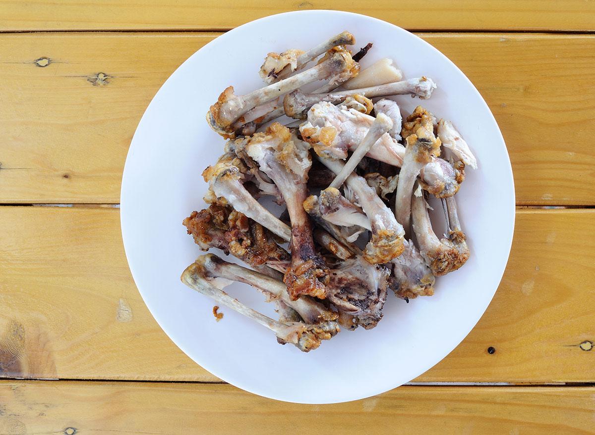 plate of cooked chicken bones