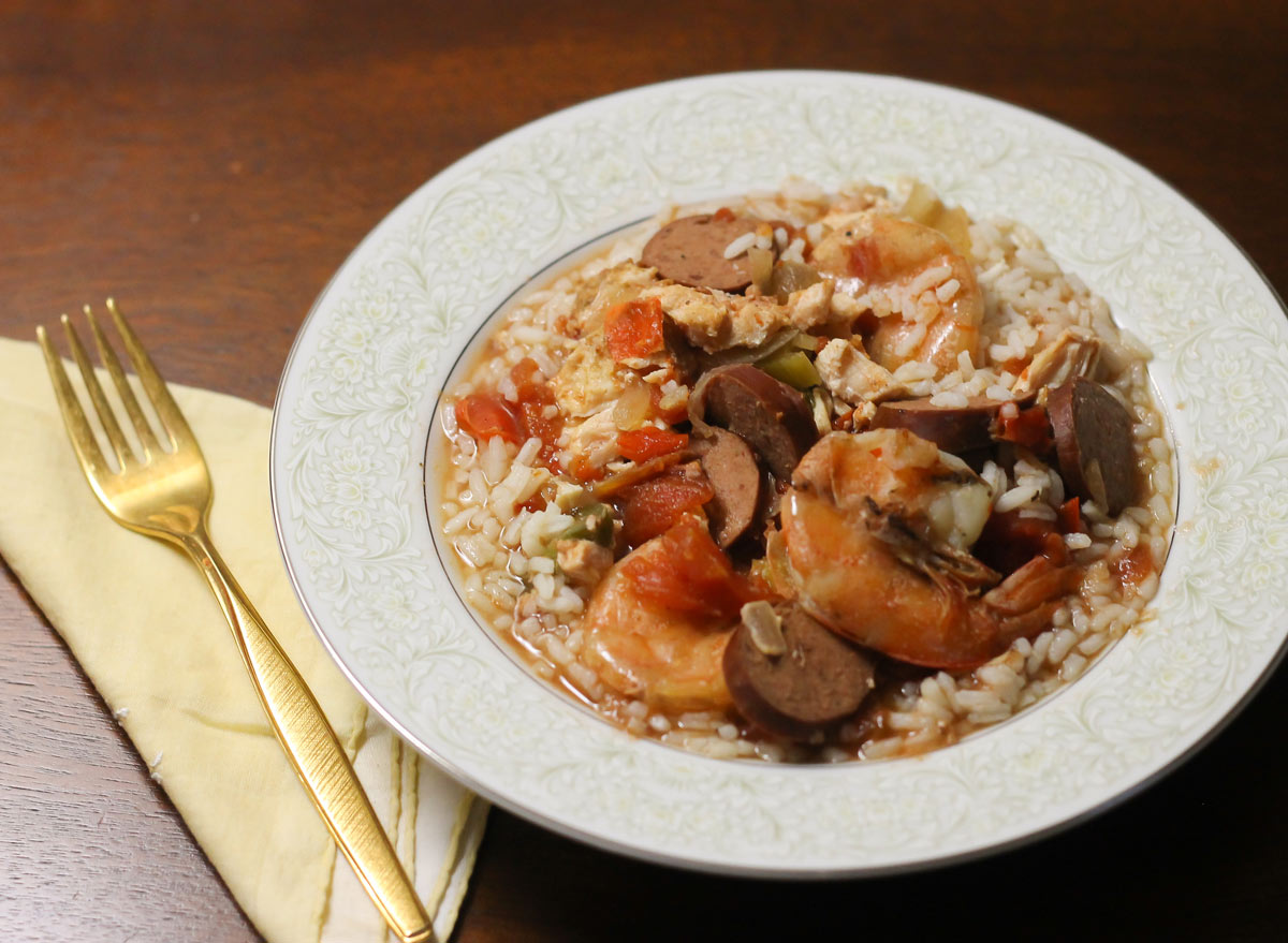 Crock pot jambalaya in a bowl on a bed of rice ready to eat.