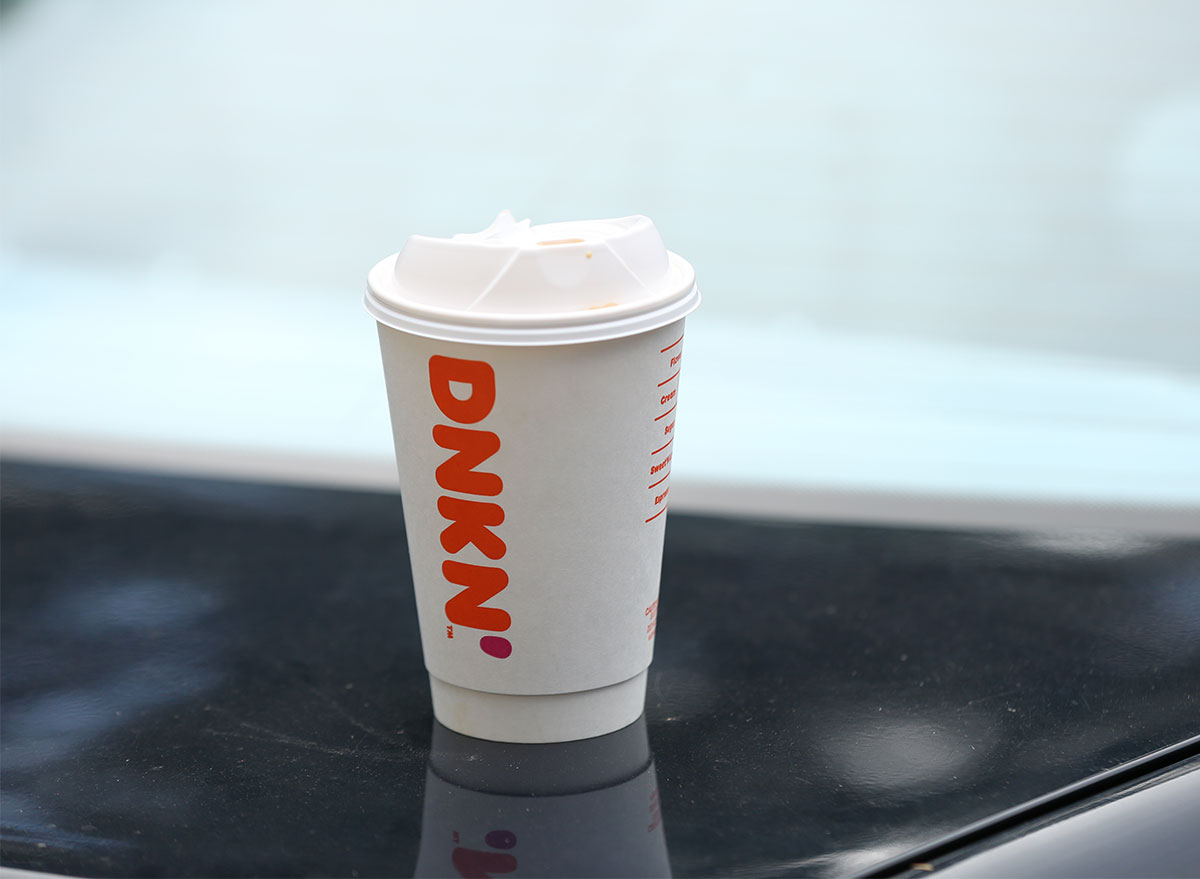 dunkin coffee cup on table