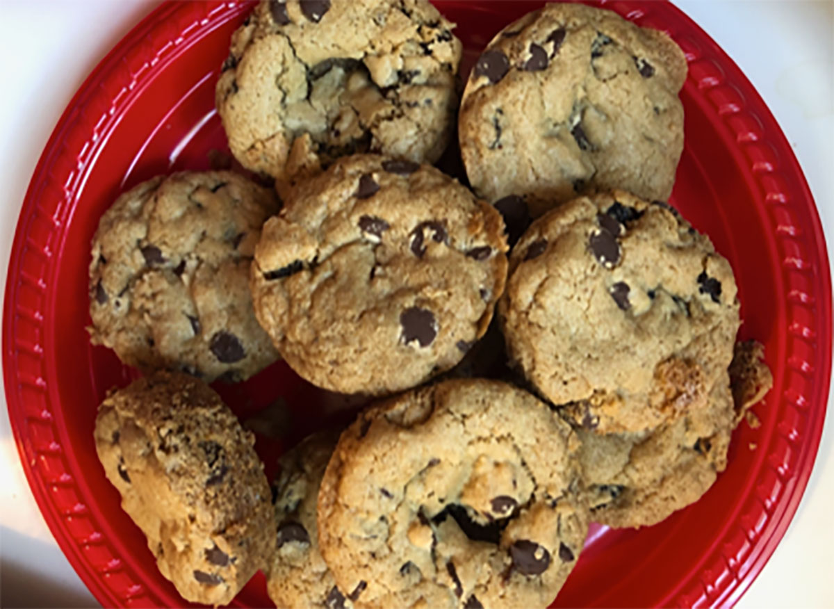 dylan lauren chocolate chip cookies on red plate