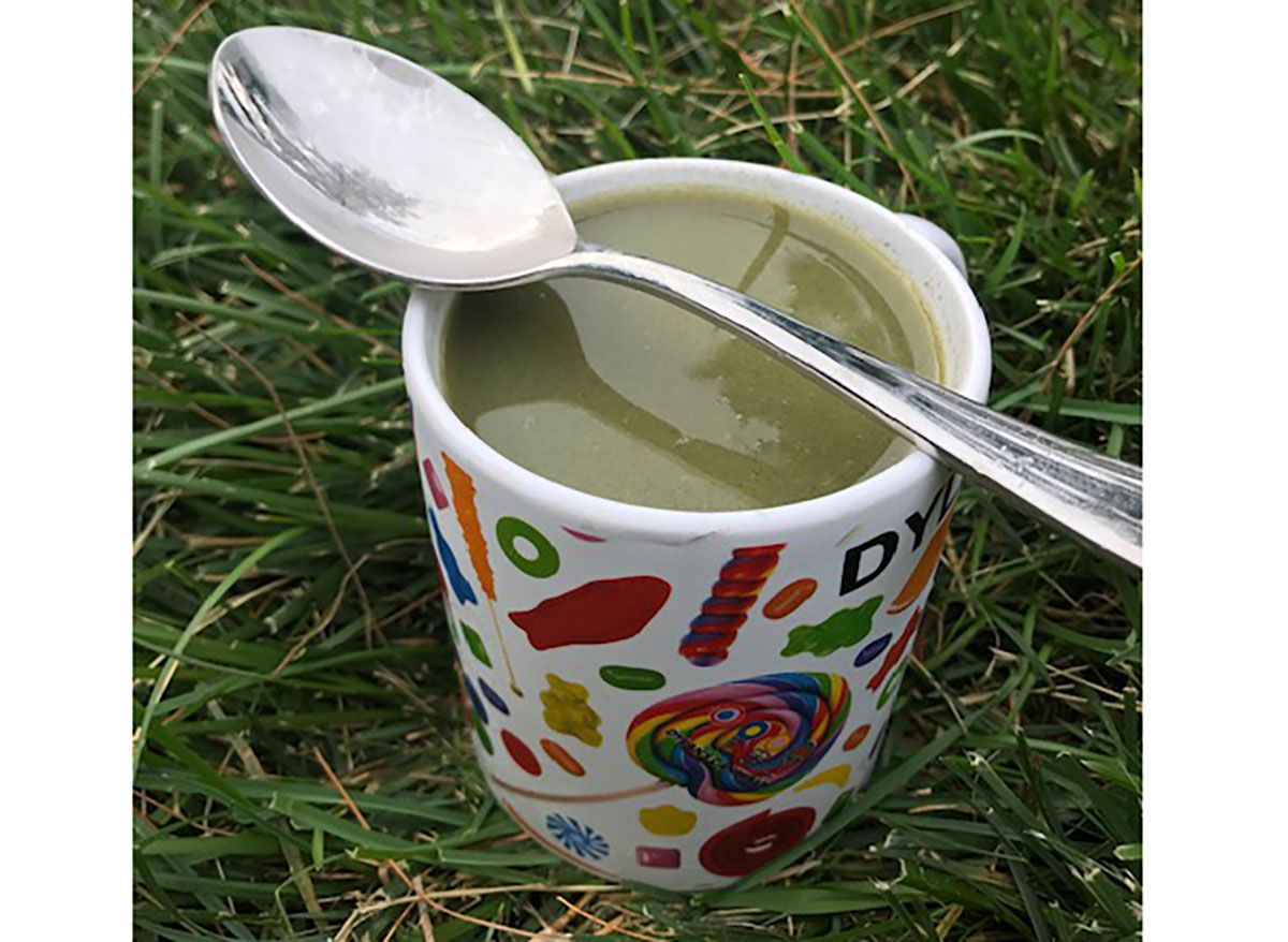 dylan lauren green juice in personalized dylans candy bar mug on grass with spoon
