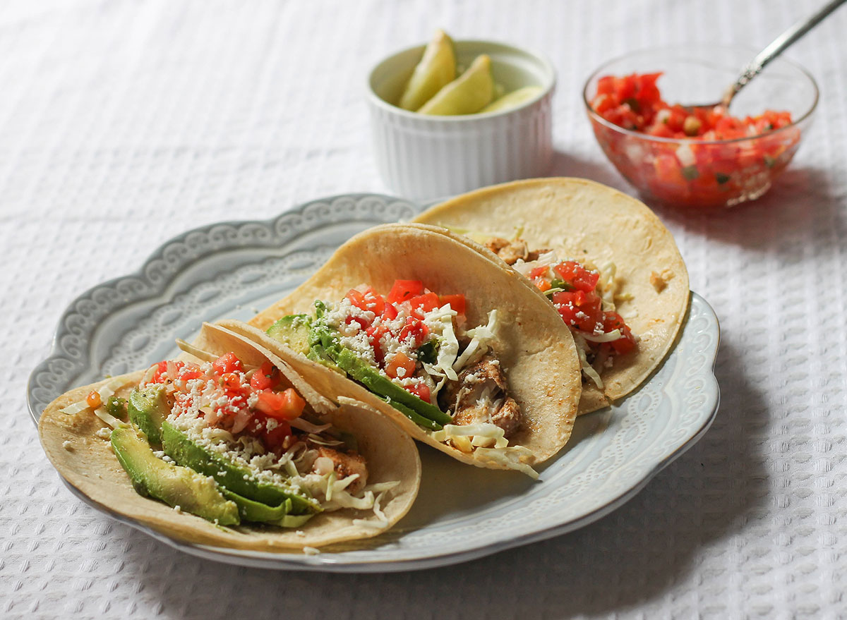 Three fish tacos on a plate