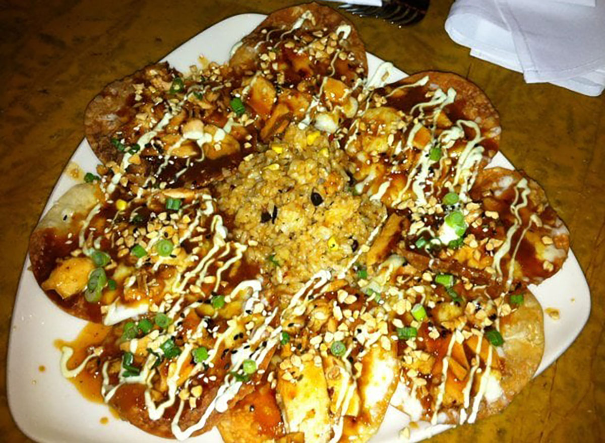 grand lux cafe asian nachos on white plate
