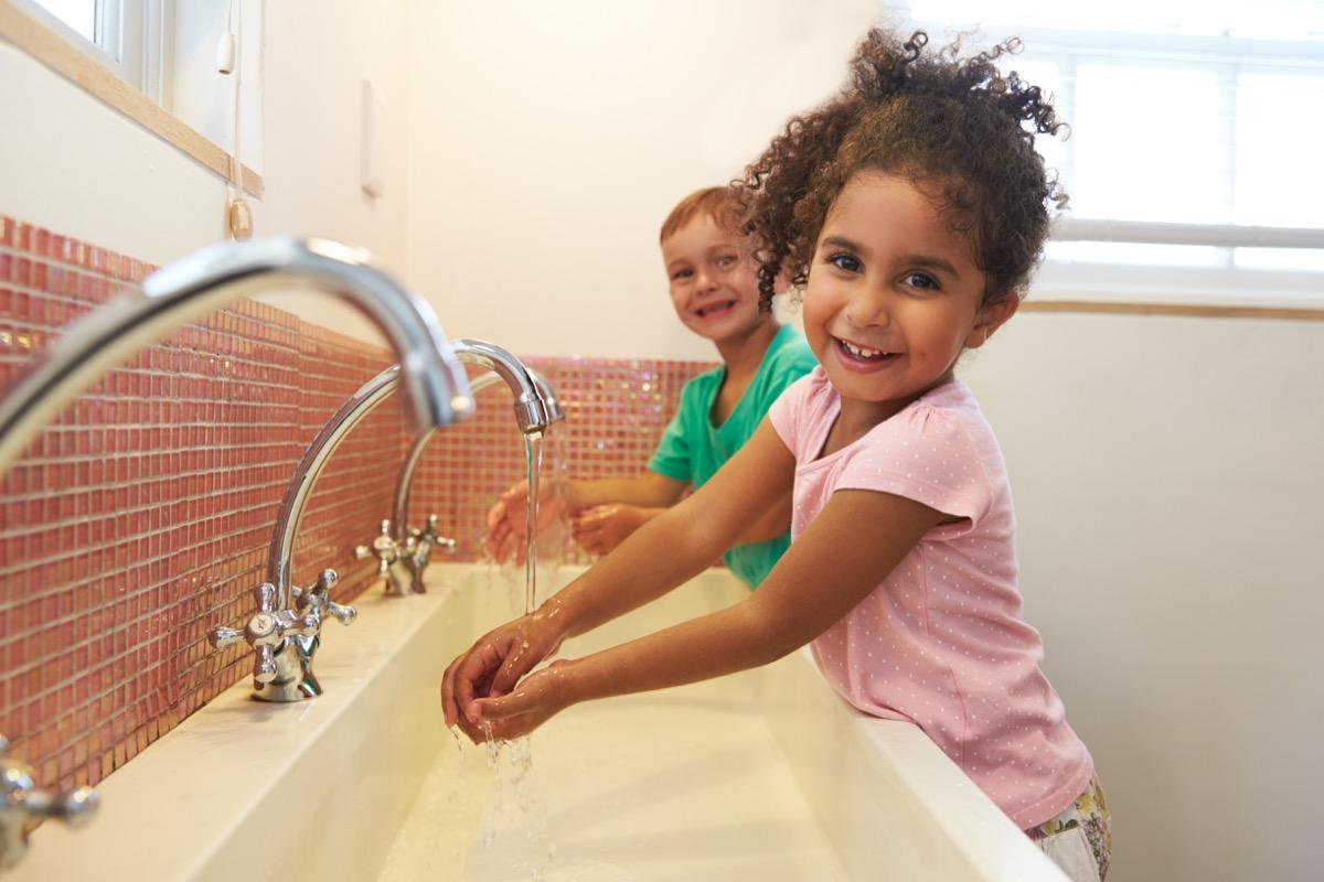 Kids at School Washing Hands In Washroom