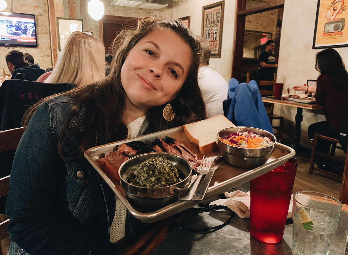 kiersten hickman with a plate of bbq in texas