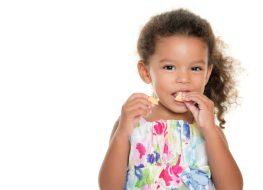 little girl eating cracker, gluten-free snacks