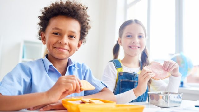 little boy and girl eating snack at school, peanut free preschool snacks