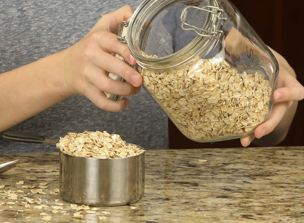 rolled cut oats being measured