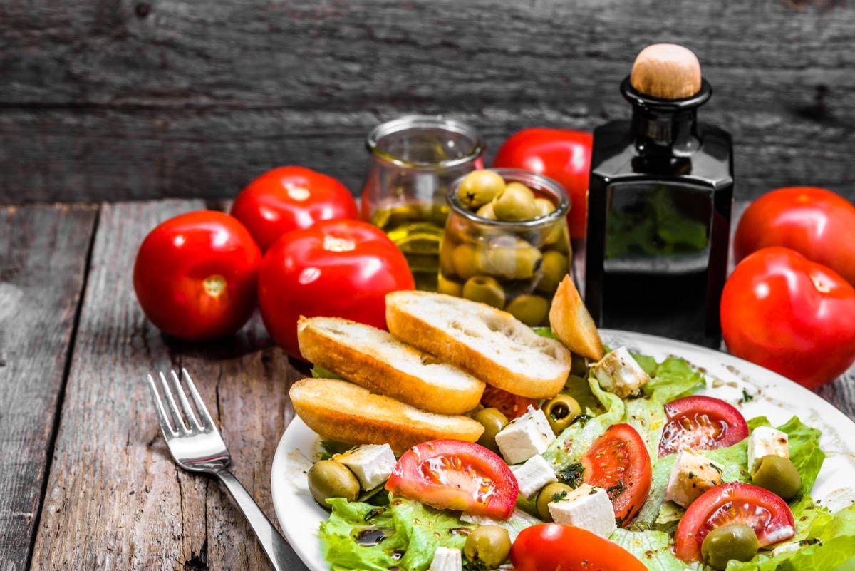 Plate of salad, greek food, mediterranean diet with vegetables and feta