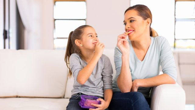 child and mother eating crackers, gluten-free snacks