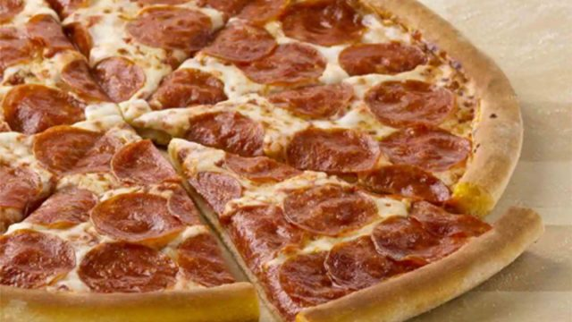 papa johns pepperoni pizza with slice being served