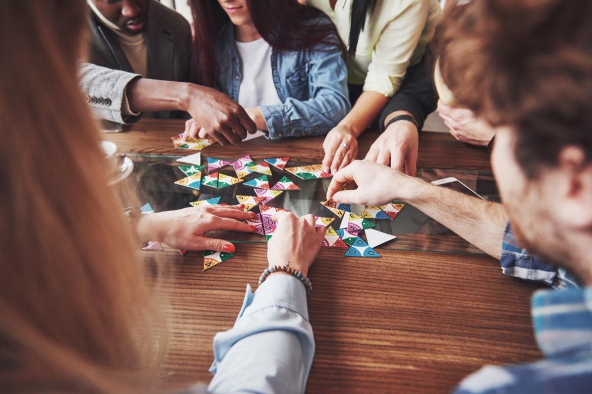 People having fun while playing board game