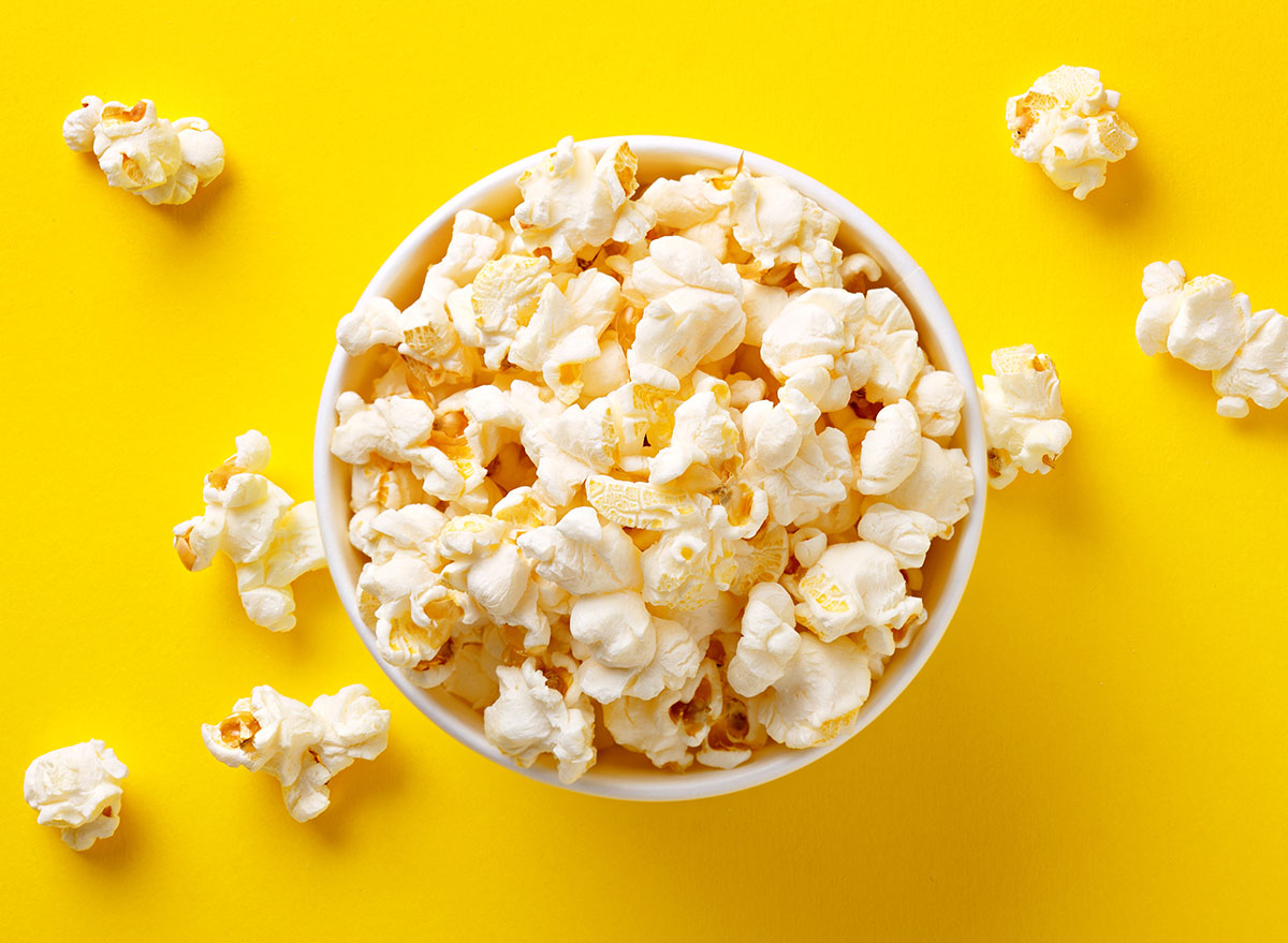 cup of popcorn against yellow backdrop