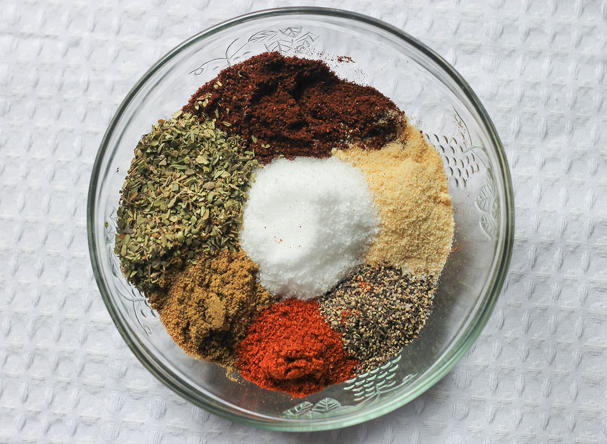 Taco seasoning separated before mixed in a bowl.
