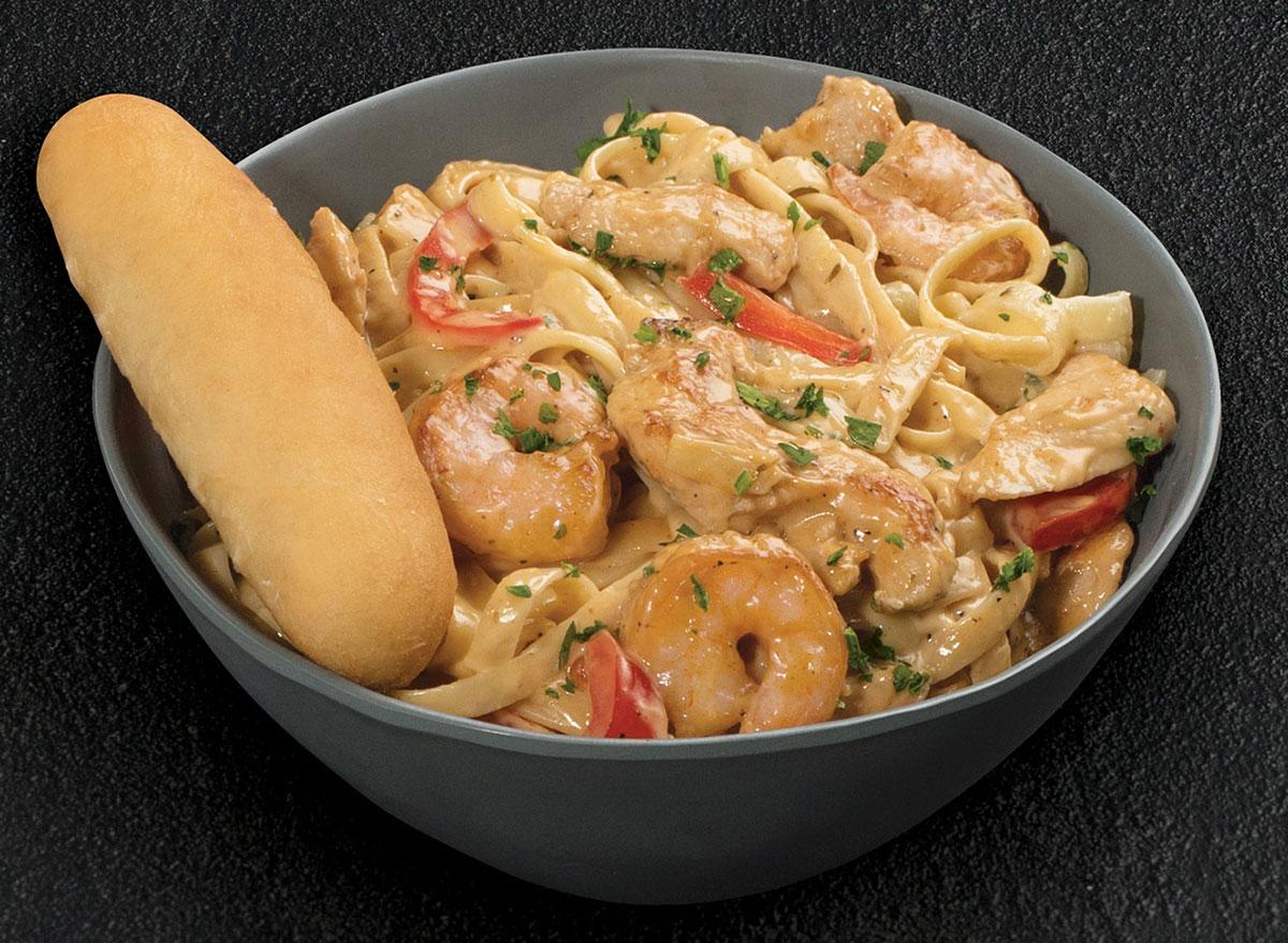 tgi fridays cajun shrimp and chicken pasta bowl on black background