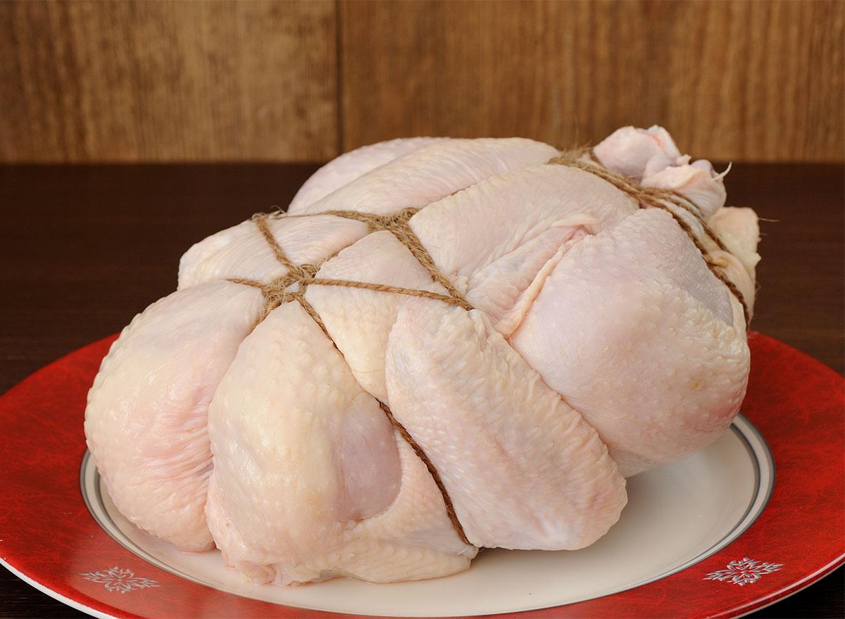tied raw chicken