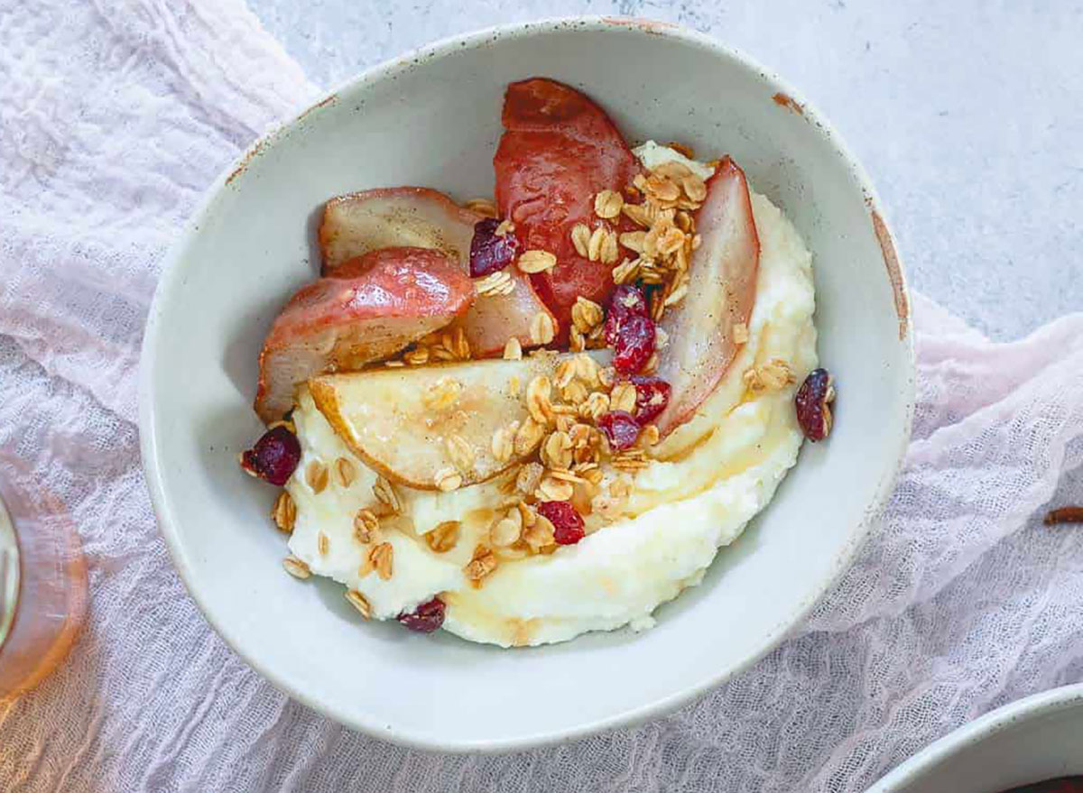 whipped ricotta bowl with roasted pears running to the kitchen