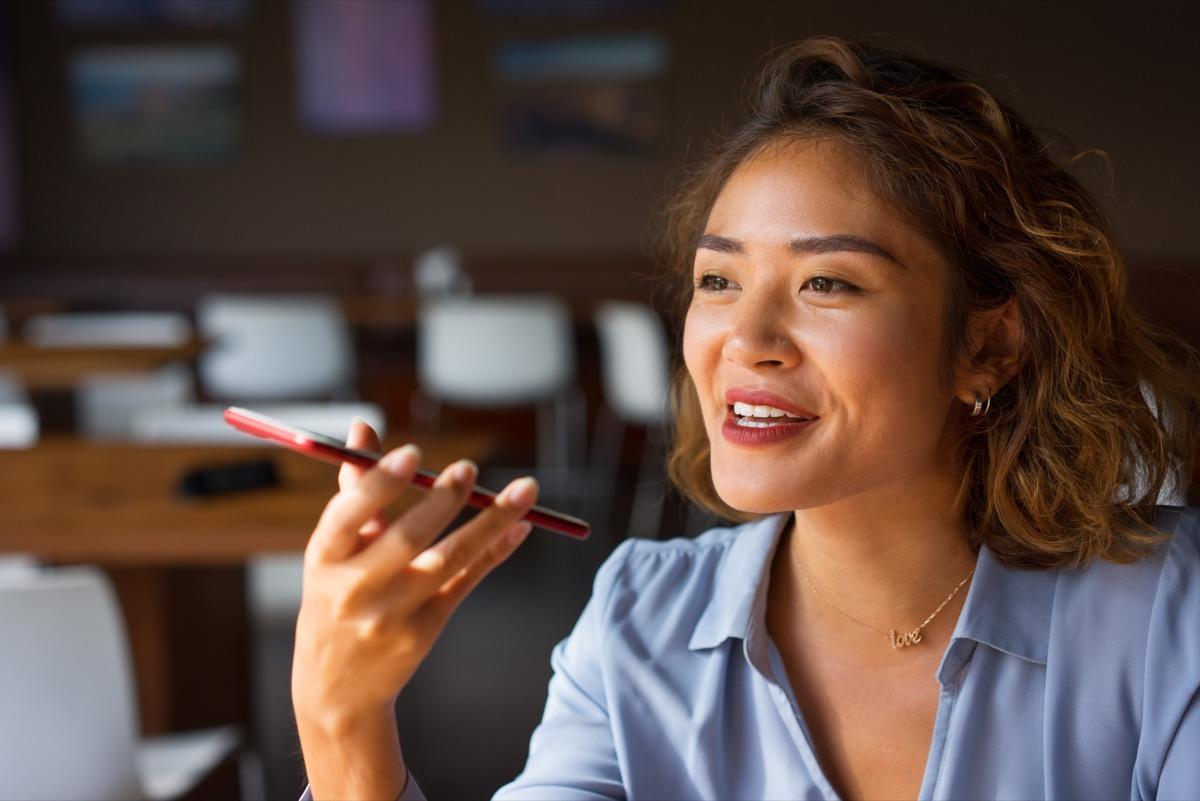 Woman Talking on Phone with Loudspeaker