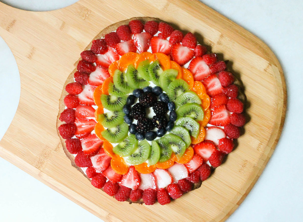 Whole fruit pizza ready to slice up for dessert