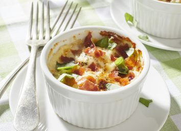 baked eggs in cream with prosciutto parmesan basil