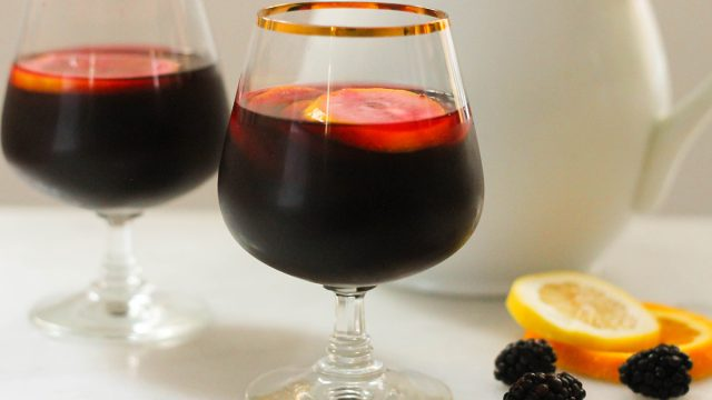 Copycat Carrabbas Blackberry Sangria in two glasses with a pitcher