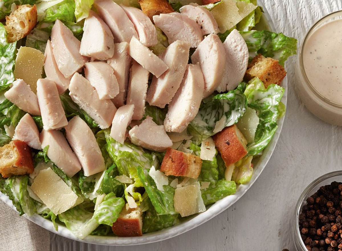 boston market chicken caesar salad in a bowl