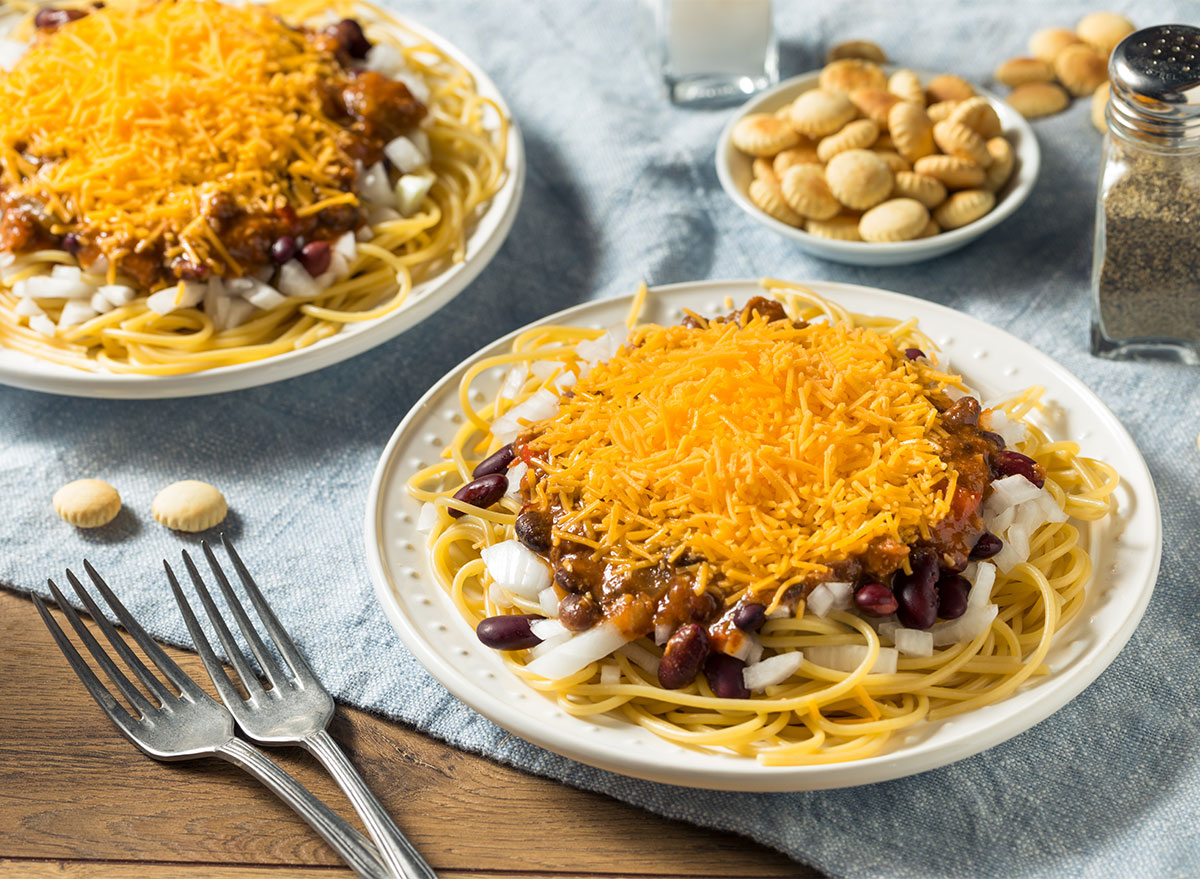 plates of cincinnati chili topped with cheddar cheese