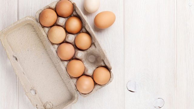 eggs in carton on wood table