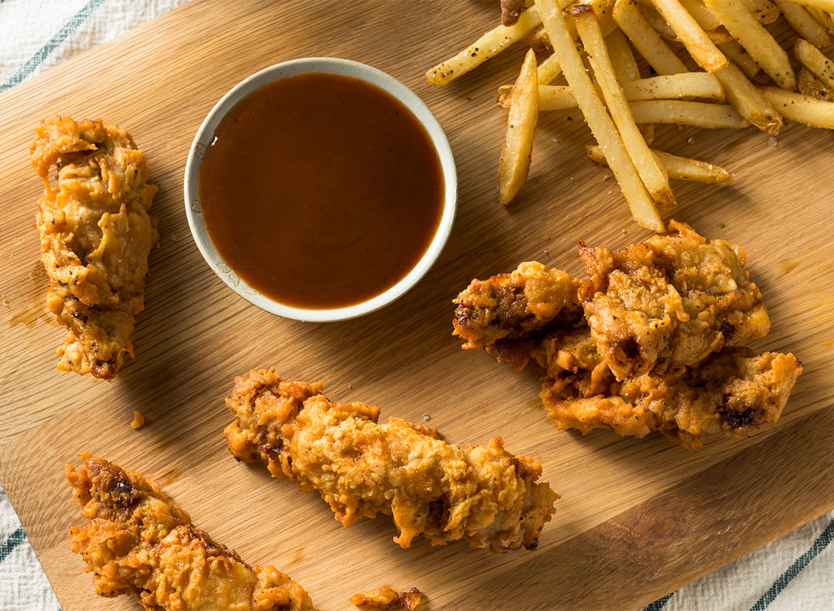 finger steak pieces with fries and dipping sauce