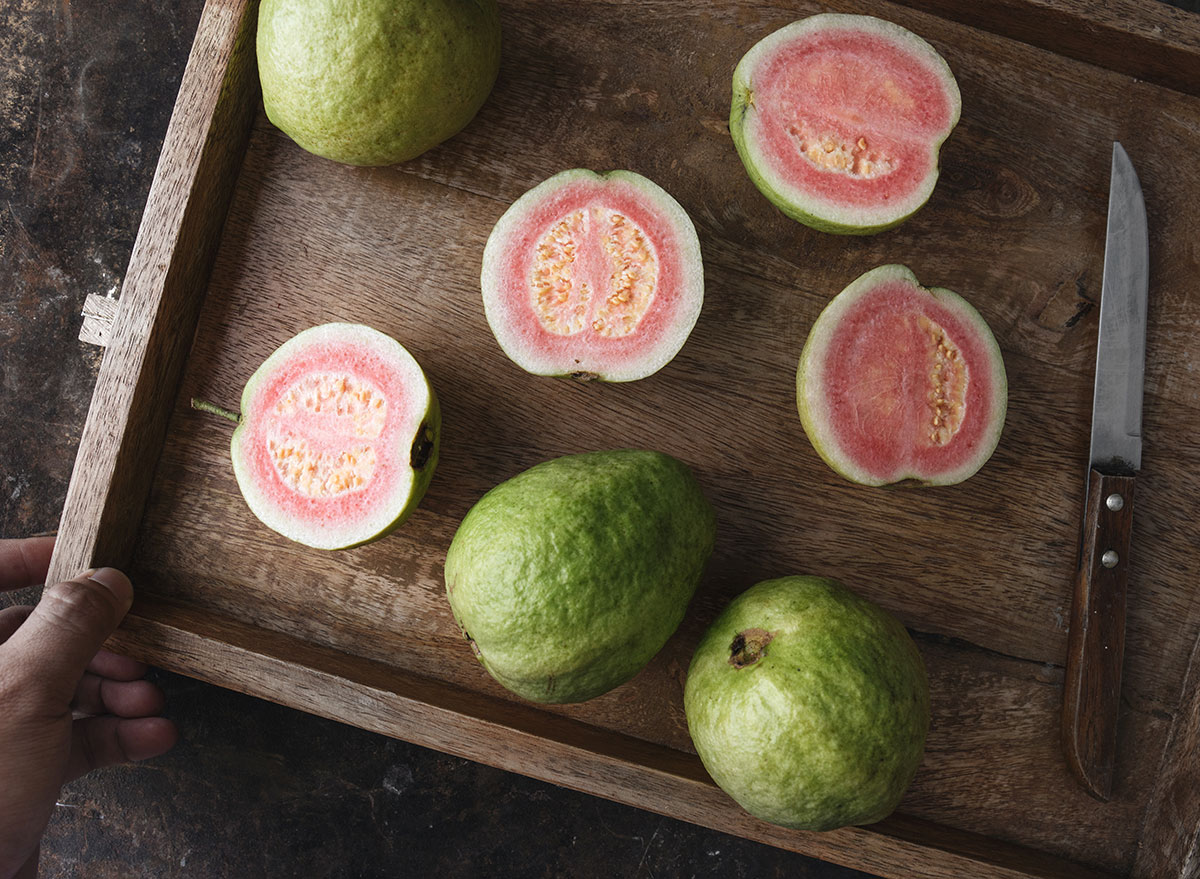fresh guava slices with knife