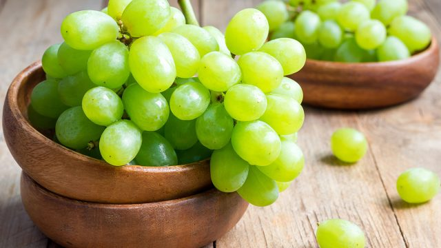 green grapes bunch in bowl