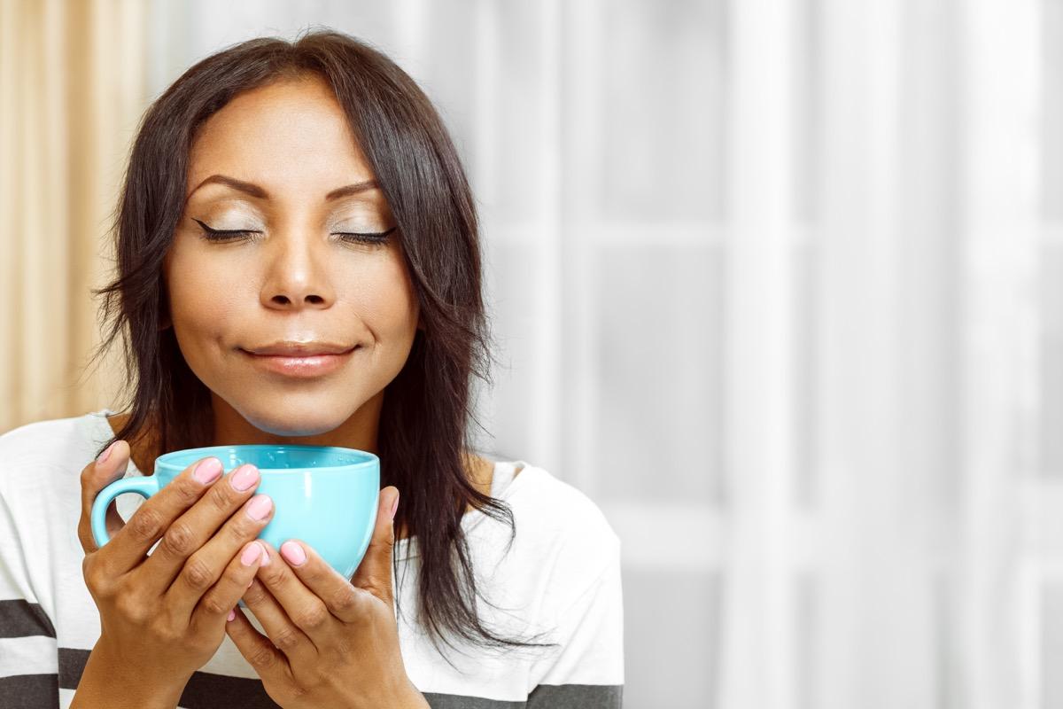 Woman enjoying coffee in the morning