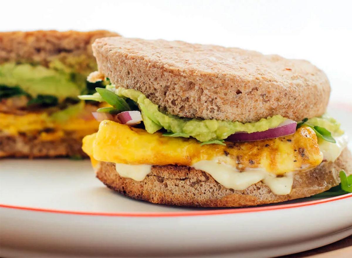 Healthy breakfast sandwich with avocado spread and egg
