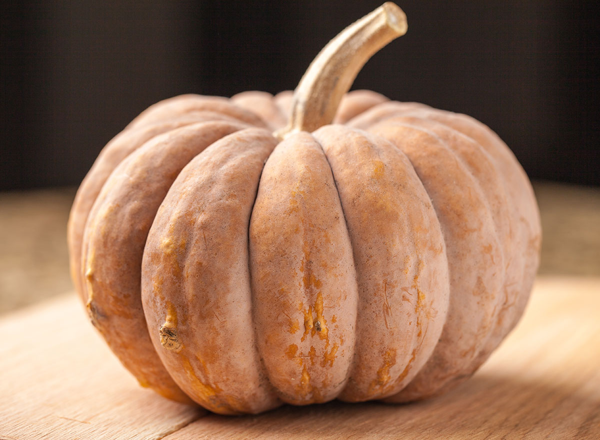 long island cheese pumpkin on wooden table
