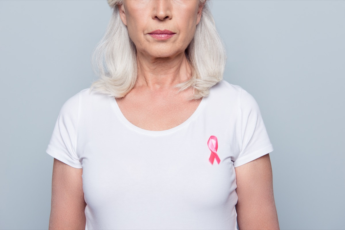woman in white t-shirt with breast cancer pink ribbon