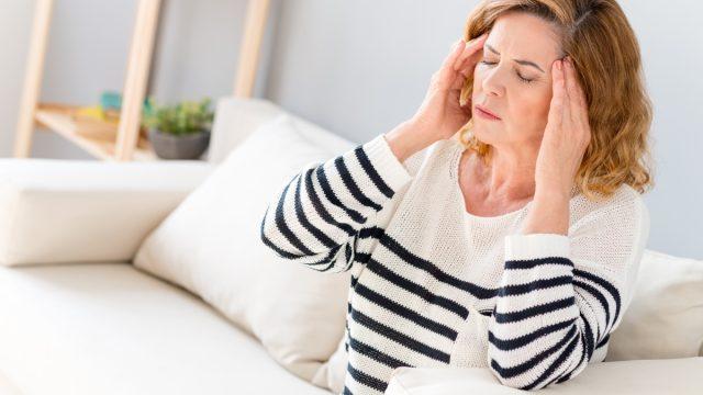 Senior woman feels pain in head