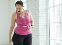 Overweight woman checking the scale