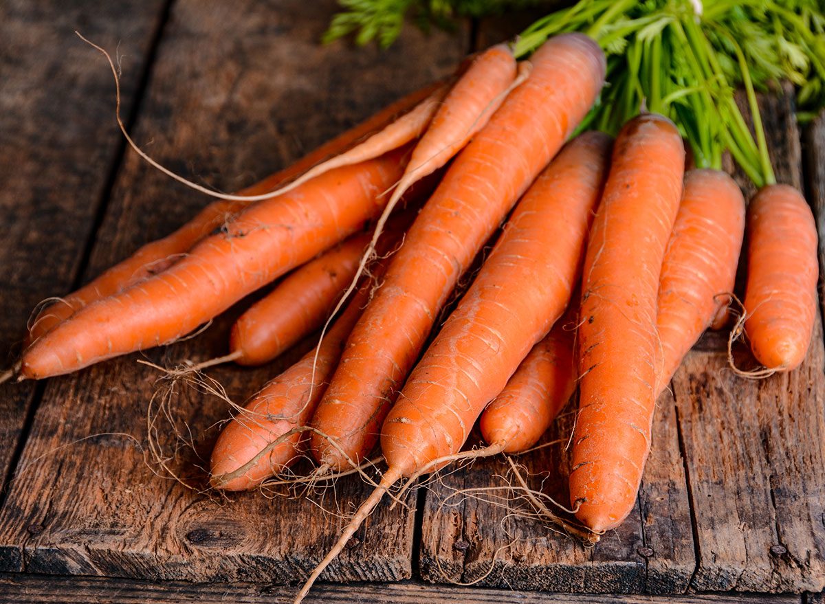 organic carrots on wood