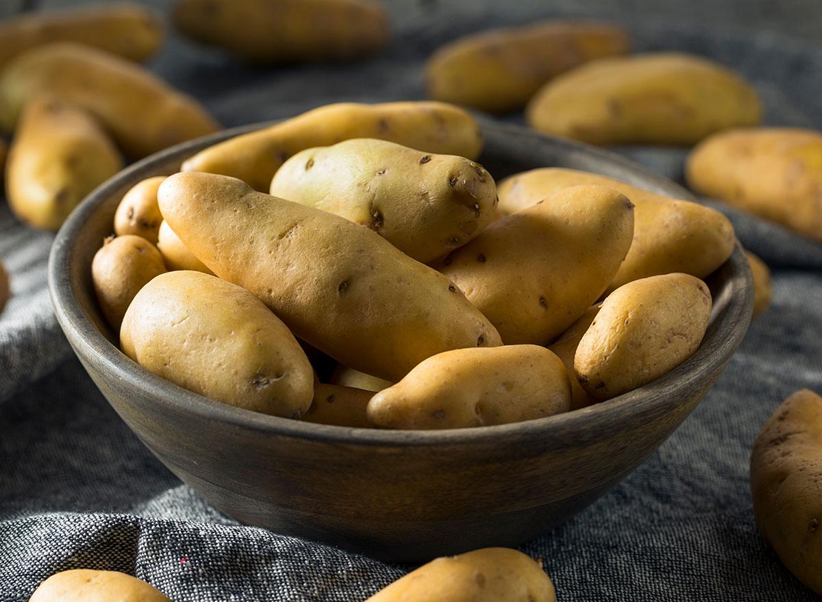 raw yellow fingerling potatoes in bowl