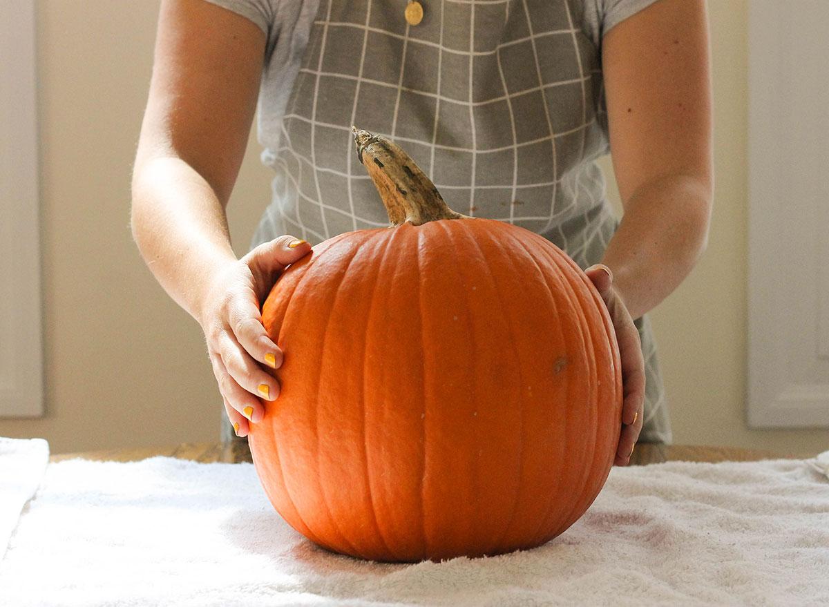 Medium size pumpkin on a table with a towel