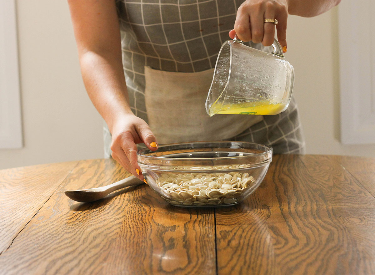 Pouring butter into pumpkin seeds
