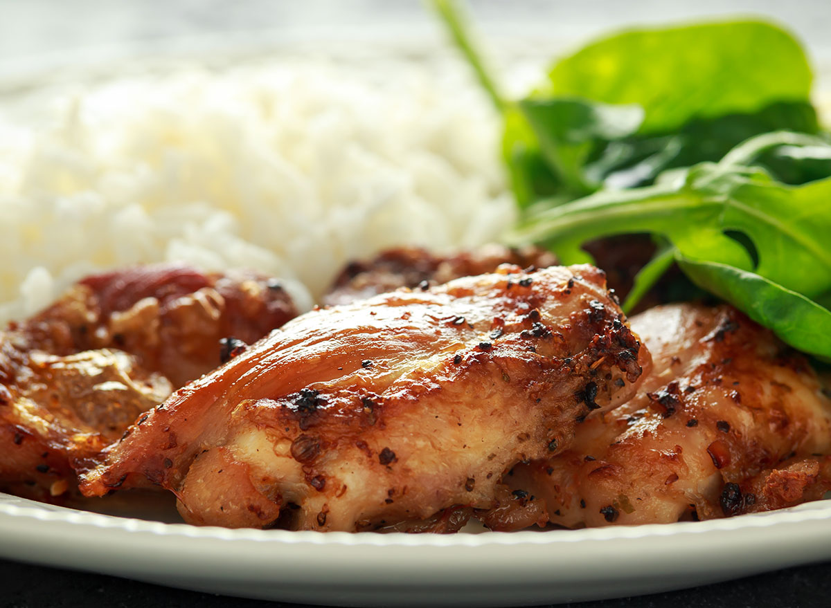 skinless chicken on a plate with greens