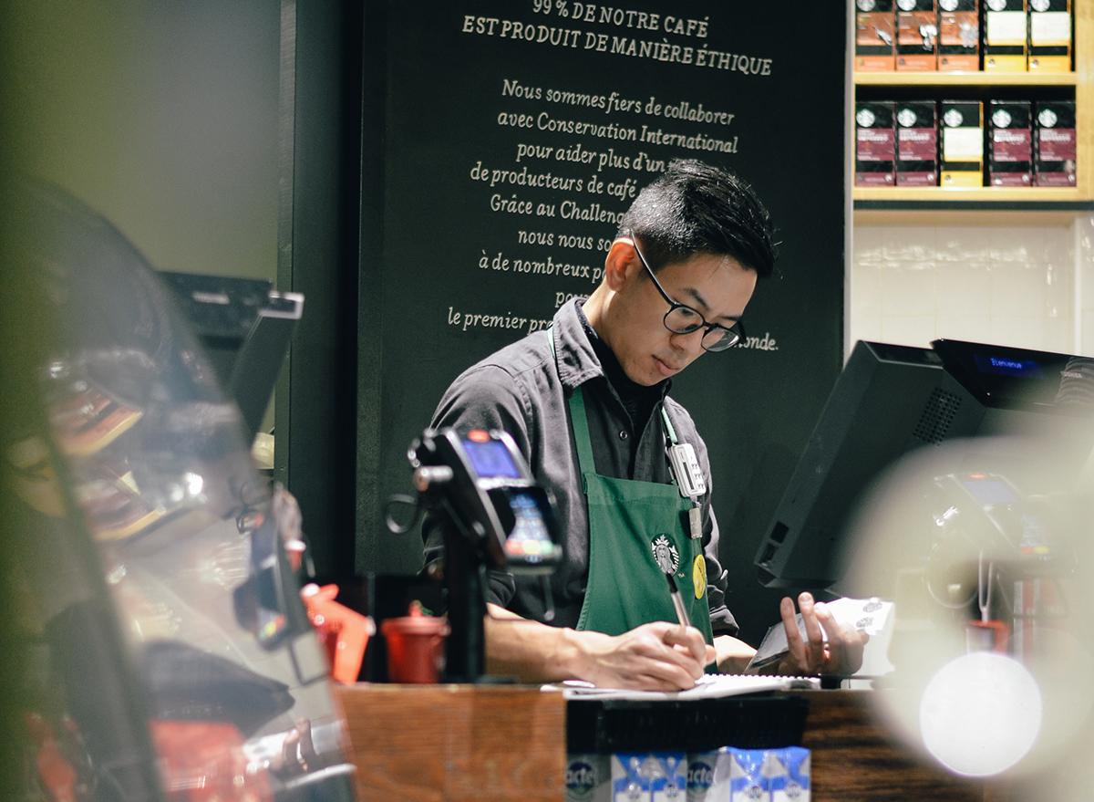 Starbucks barista working behind the counter