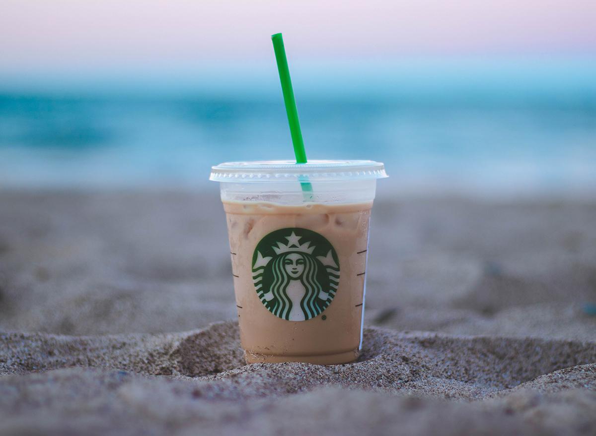 Starbucks iced coffee cup on a beach