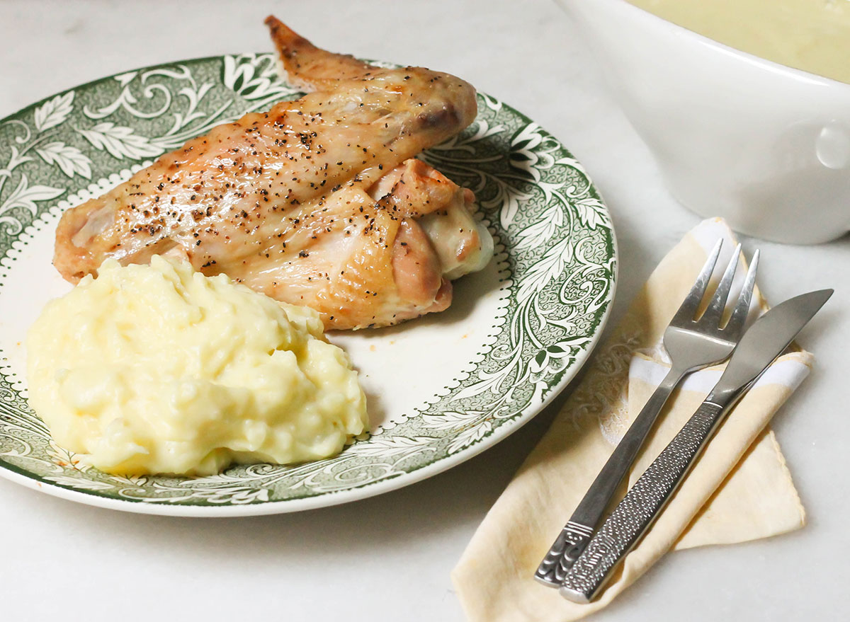 baked turkey wings with mashed potatoes on plate
