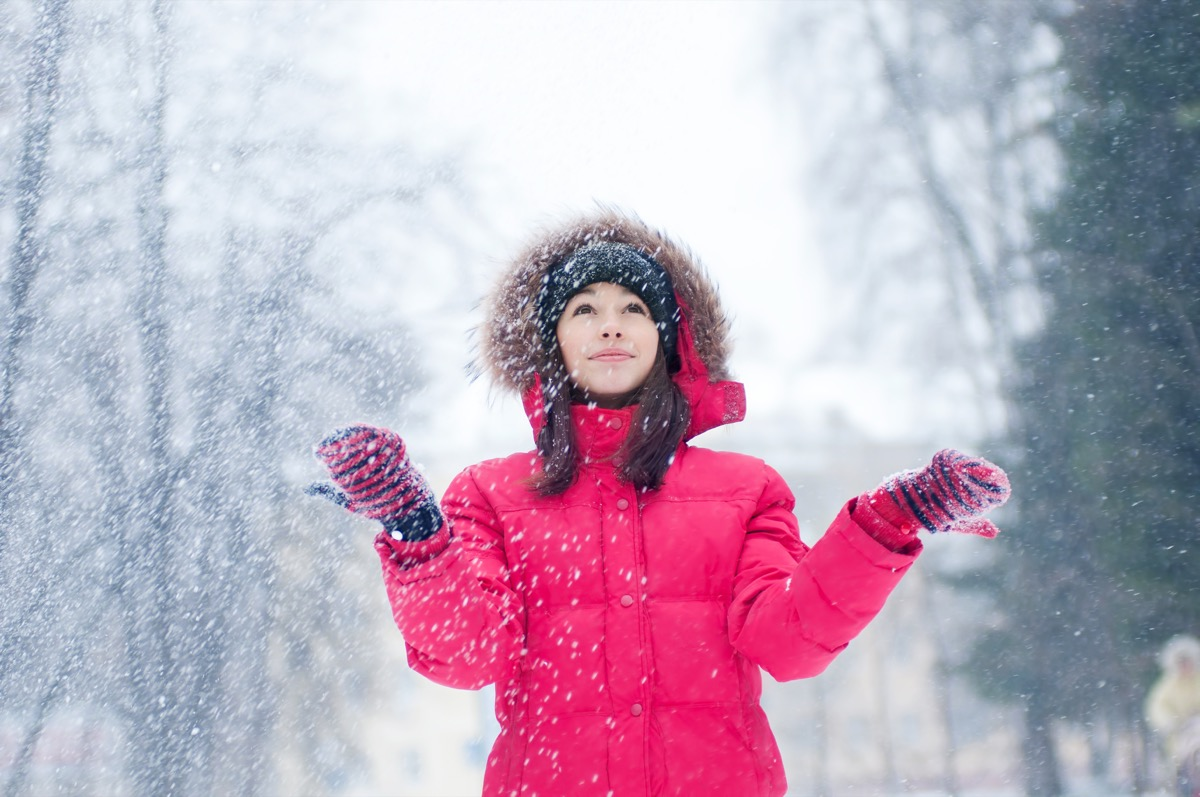 woman plays with a snow outdoor