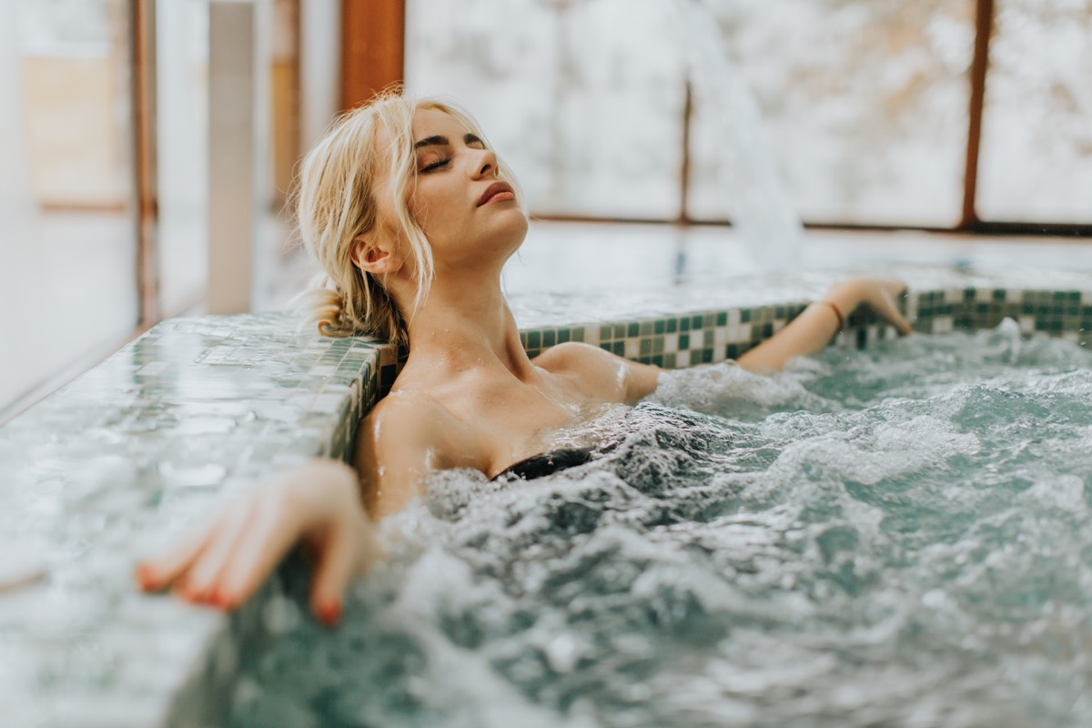 woman relaxing in the whirlpool bathtub